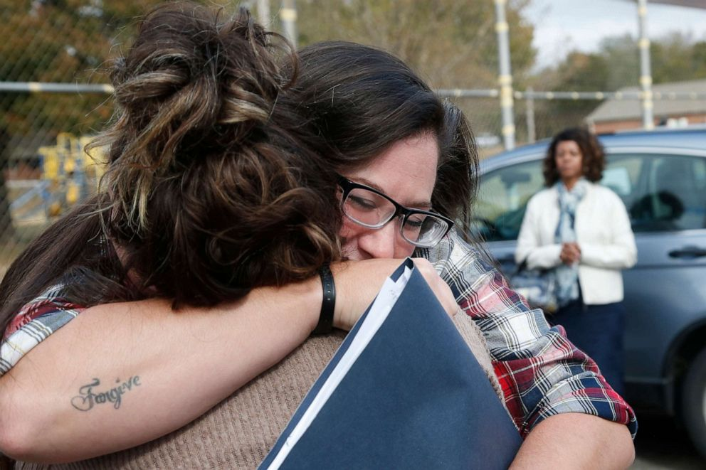 PHOTO: Danni Sloan Roberts, right, embraces her sister Sydney Roberts, left, after being released from the Eddie Warrior Correctional Center Monday, Nov. 4, 2019, in Taft, Okla.