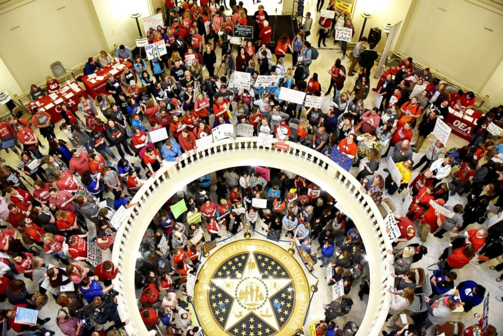 PHOTO: Teachers pack the state Capitol rotunda to capacity, on the second day of a teacher walkout, to demand higher pay and more funding for education, in Oklahoma City, Okla., on April 3, 2018.