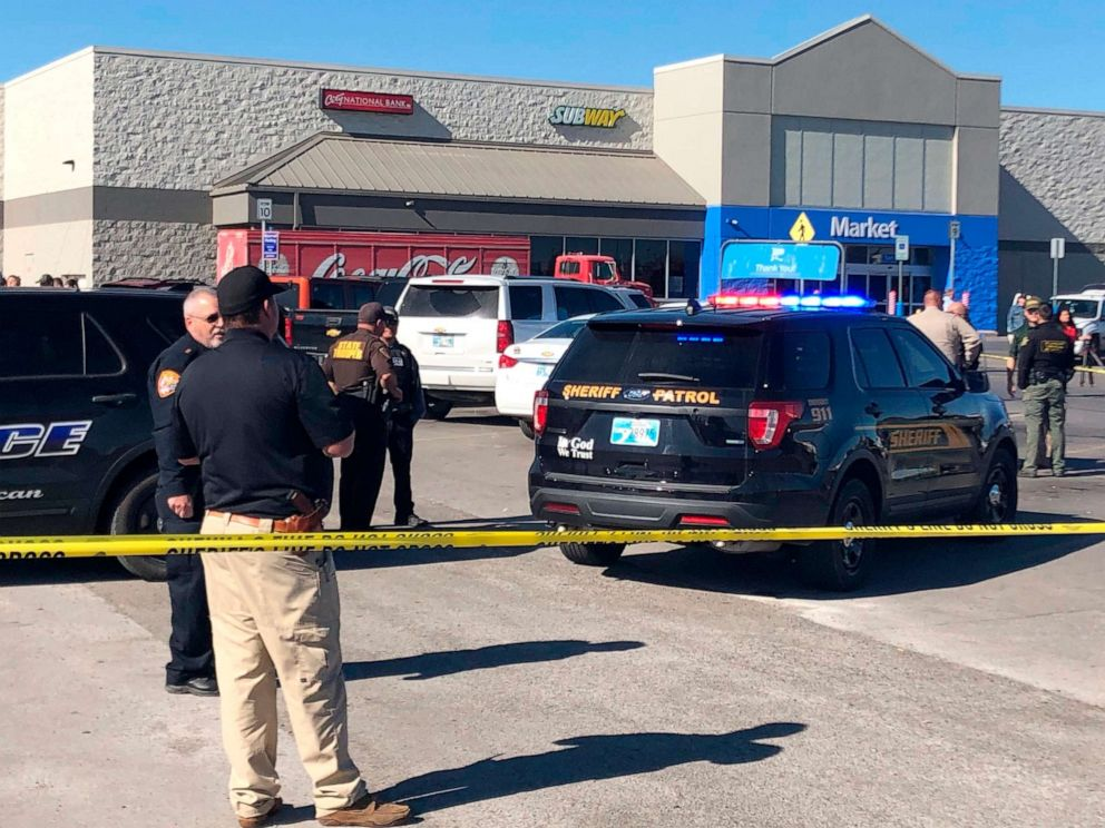 PHOTO: Law enforcement work the scene where two men and a woman were fatally shot Nov. 18, 2019, outside a Walmart store in Duncan, Okla.