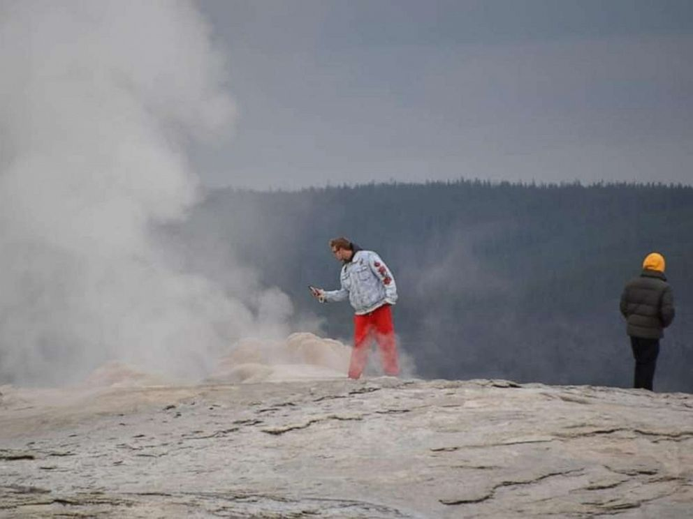 PHOTO: Two men face criminal charges for walking onto Old Faithful Geyser in Yellowstone National Park.