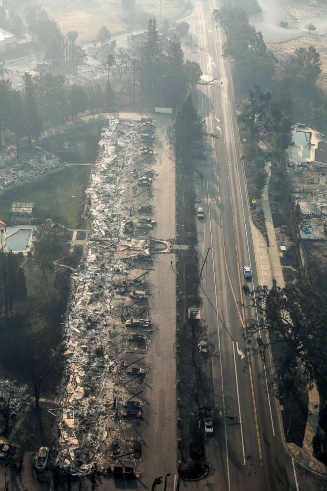 A firestorm that began in Napa Valley's Calistoga destroys hundreds of homes in the Mark West Estate neighborhood along Old Redwood Highway as viewed in this aerial photo taken, Oct. 11, 2017, in Santa Rosa, Calif.