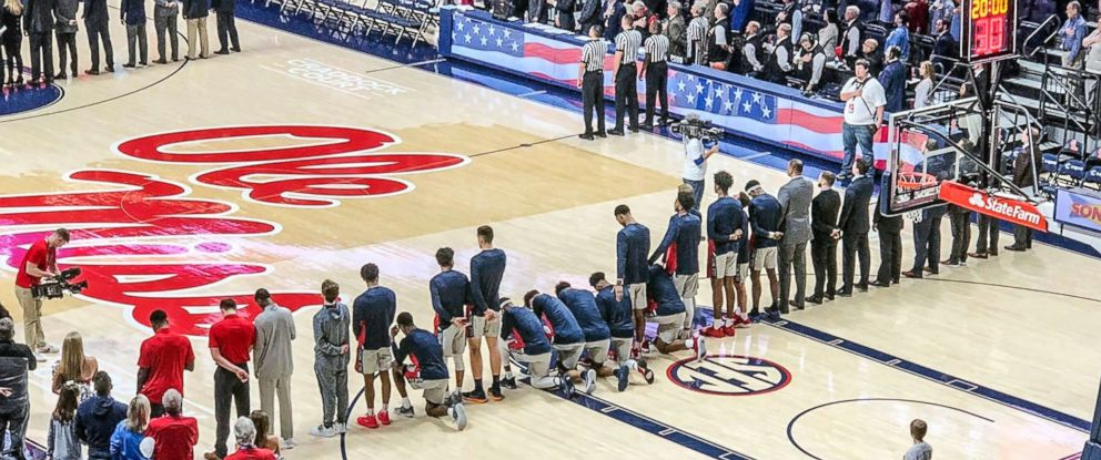 PHOTO: Six Mississippi basketball players take a knee during the national anthem before an NCAA college basketball game against Georgia in Oxford, Miss., Feb. 23, 2019.