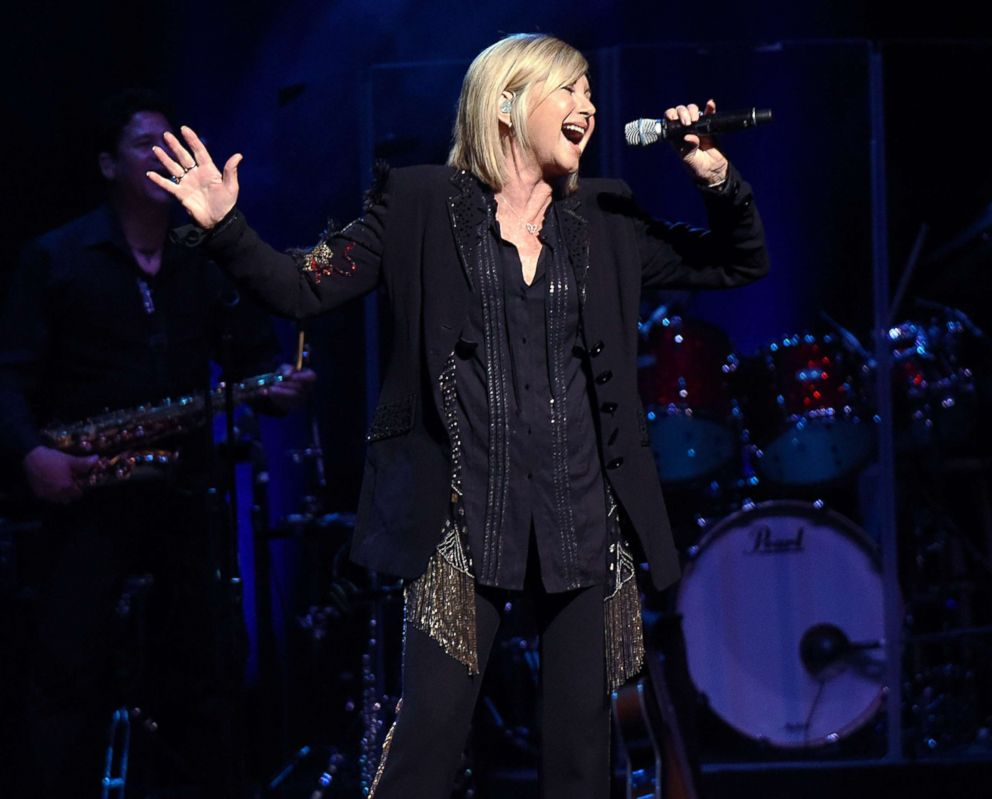 PHOTO: Olivia Newton-John performs at Cobb Energy Centre on April 9, 2017, in Atlanta, Georgia.