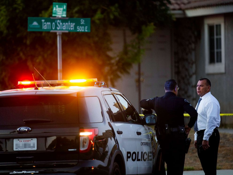 PHOTO: Ontario Police stand outside the scene where two children, an infant and a teenager, were found dead with their mother, who was unresponsive, at a home, Aug. 20, 2019, in Ontario, Calif.