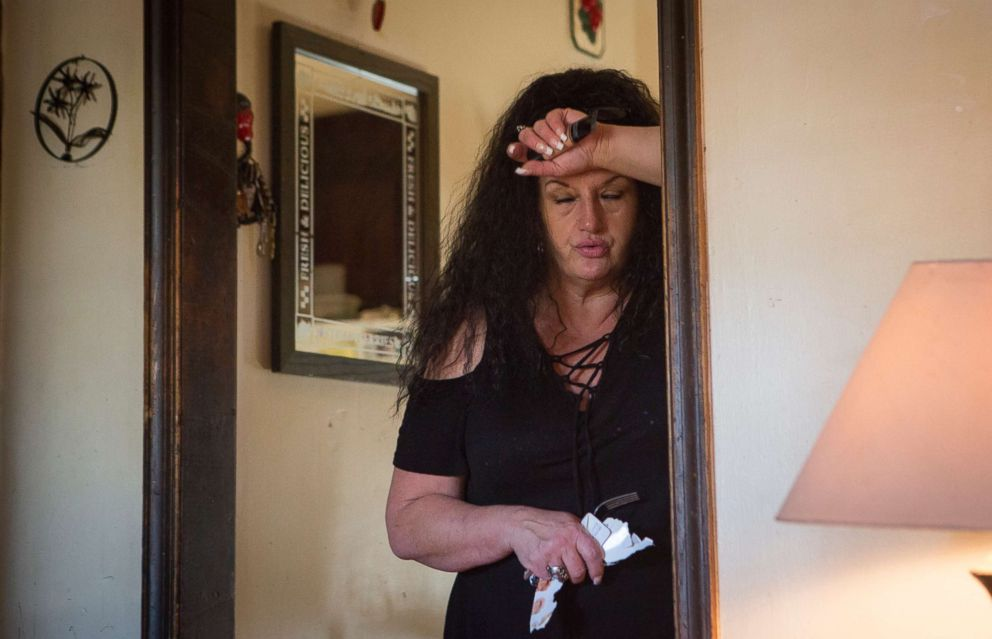 PHOTO: Deborah Crowder catches her breath as her youngest grandson, Jaydain, starts crying. Deborah has custody of four of her grandsons whose mother is in jail. The house can be exhausting, I havent had my house to myself in 12 years, she said.