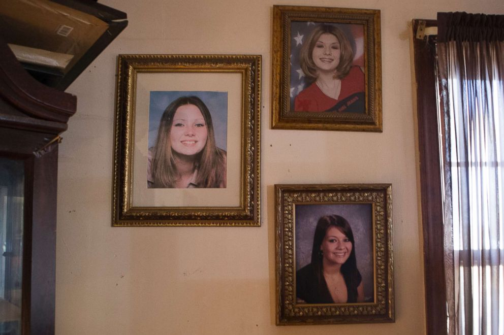 PHOTO: Portraits of Tera, left, and Stephanie, bottom right, taken when they were in high school, hang on the wall of their mothers home in Chesterfield. They were beautiful girls, Deborah Crowder said.