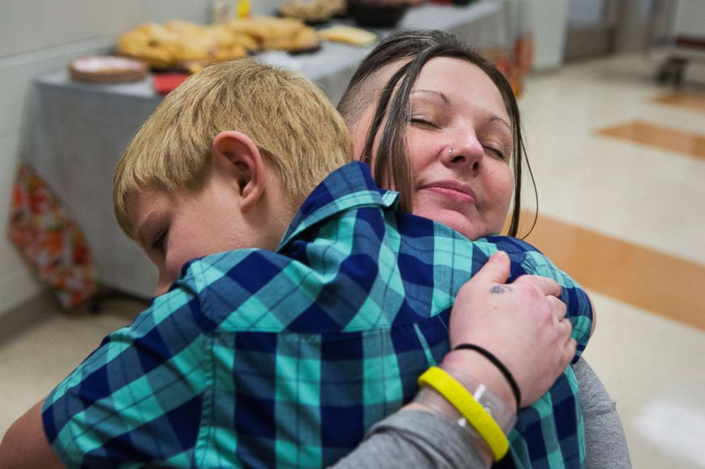 PHOTO: Tera Crowder hugs her son James, 7, during a special face-to-face visit on Thanksgiving at the Chesterfield County Jail.