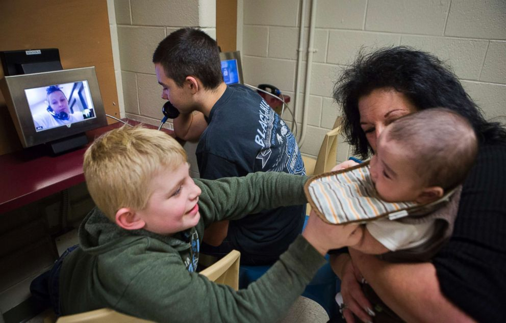 PHOTO: Jeremy talks with his mother Tera while James plays with Jaydain in his grandmother Deborah Crowders arms during a video visit with their mother, Tera, at the Chesterfield County Jail.