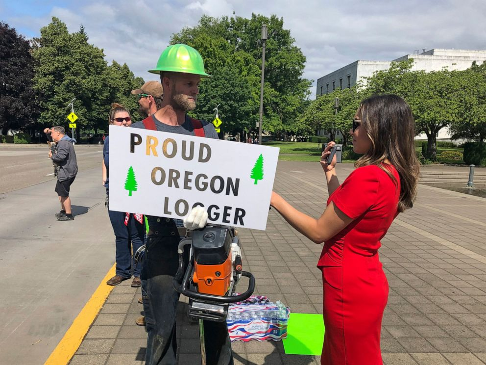 PHOTO: A TV reporter interviews self-employed logger Bridger Hasbrouck, of Dallas, Ore., outside the Oregon State House in Salem, Ore., on Thursday, June 20, 2019, the day the Senate was scheduled to take up a bill that would curb carbon emissions.