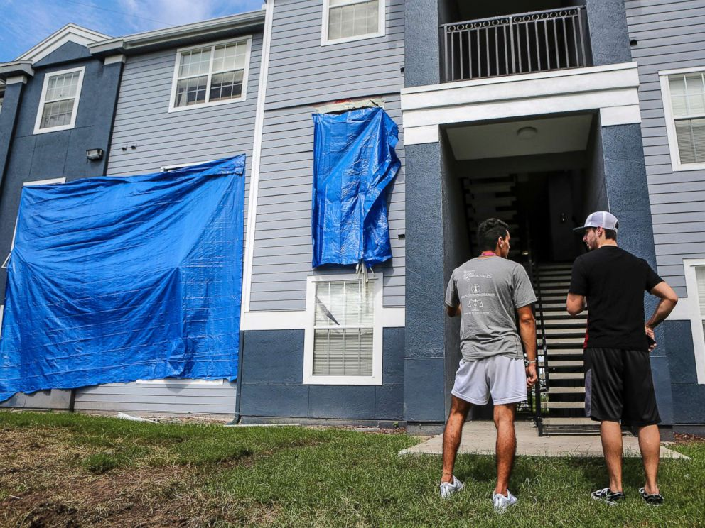 PHOTO: Residents at Westbrook Apartments get a first look at their building where a gunman held four children hostage before taking their life and his own, June 12, 2018, in Orlando, Fla.