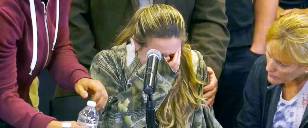 PHOTO: Meghan Valencia breaks down at a news conference as she asked for prayers for her husband, Officer Kevin Valencia, who was shot in the head by a man who allegedly killed four children he took hostage and himself.