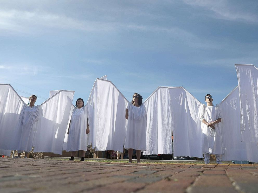 PHOTO: People dressed as angels stand in front of the memorial set up for the shooting victims at Pulse nightclub where the shootings took place two years ago, June 12, 2018, in Orlando, Fla.