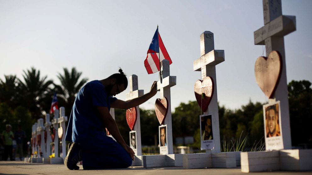 Ernesto Vergne prays at a cross honoring his friend Xavier Emmanuel Serrano Rosado and the other victims at a memorial to those killed in the Pulse nightclub mass shooting a few blocks from the club early Friday, June 17, 2016, in Orlando, Fla. Gunman Omar Mateen killed 49 people.