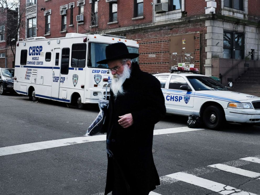 PHOTO: An Orthodox Jewish man walks past a security vehicle in the neighborhood of Crown Heights, Feb. 25, 2019, in New York City.