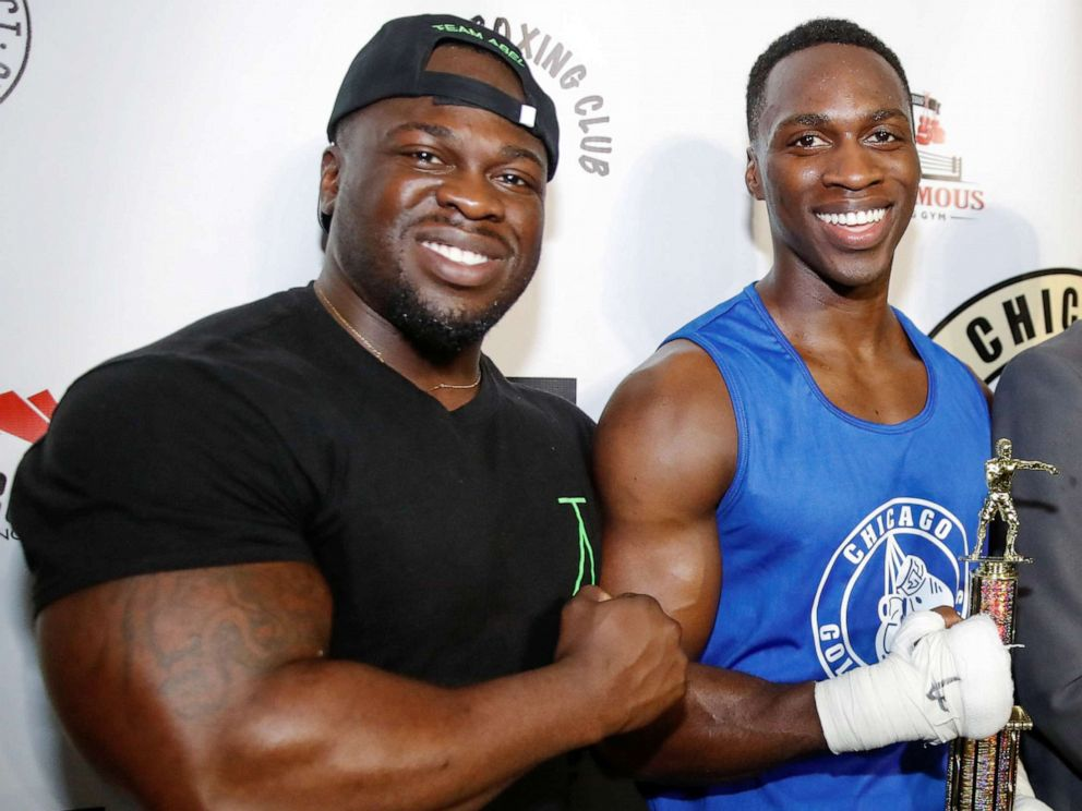 PHOTO: Abel Osundairo (left) celebrates with brother Olabinjo Osundairo after defeating John Broderick in a Golden Gloves senior novice light heavyweight division final boxing match in Chicago, April 12, 2019.