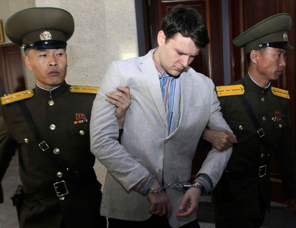 PHOTO: In this March 16, 2016, file photo, American student Otto Warmbier, center, is escorted at the Supreme Court in Pyongyang, North Korea.