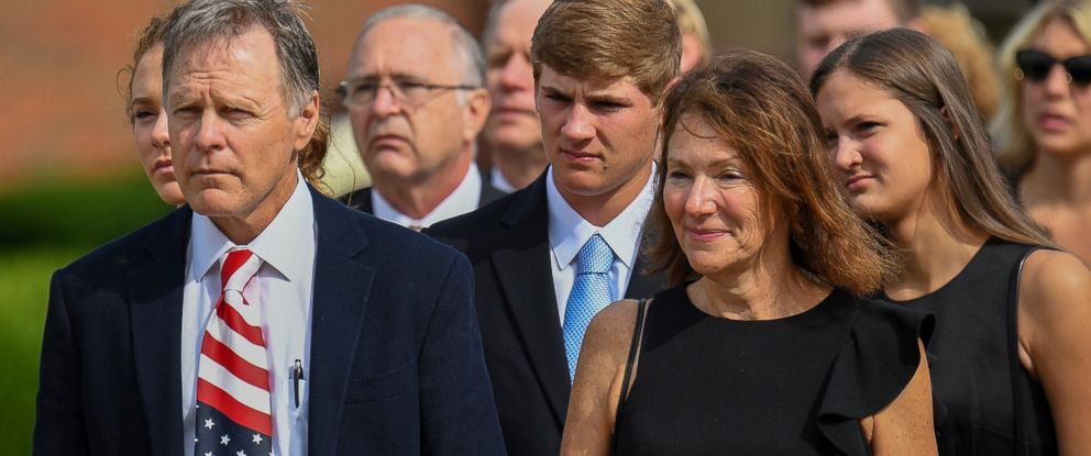 PHOTO: Fred and Cindy Warmbier watch as the casket for their son Otto is placed in a hearse after his funeral in Wyoming, OH., June 22, 2017.