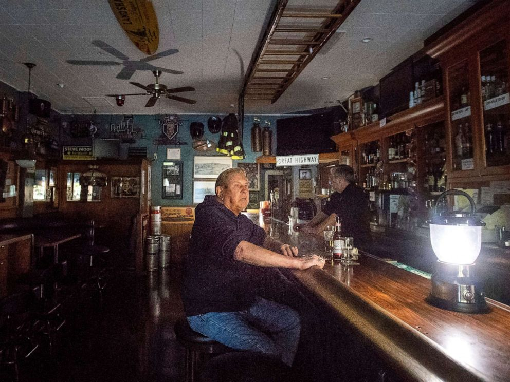 PHOTO: Joseph Pokorski drinks a beer at The Town Square as downtown Sonoma, Calif., remains without power, Oct. 9, 2019.