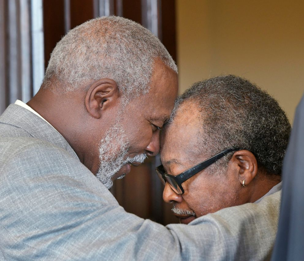 PHOTO: Nathan Myers, left, hugs his uncle Frank Williams after the 1976 murder convictions of Myers and his other uncle, Clifford Williams, were overturned Thursday, March 28, 2019 at the Duval County Courthouse in Jacksonville, Fla.