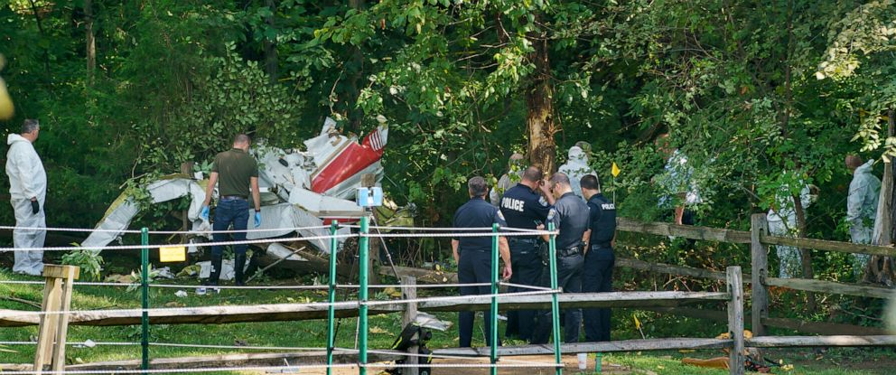 PHOTO: Officials investigate the scene where a small aircraft crashed in a residential neighborhood in Upper Moreland, Pa., Aug. 8, 2019.
