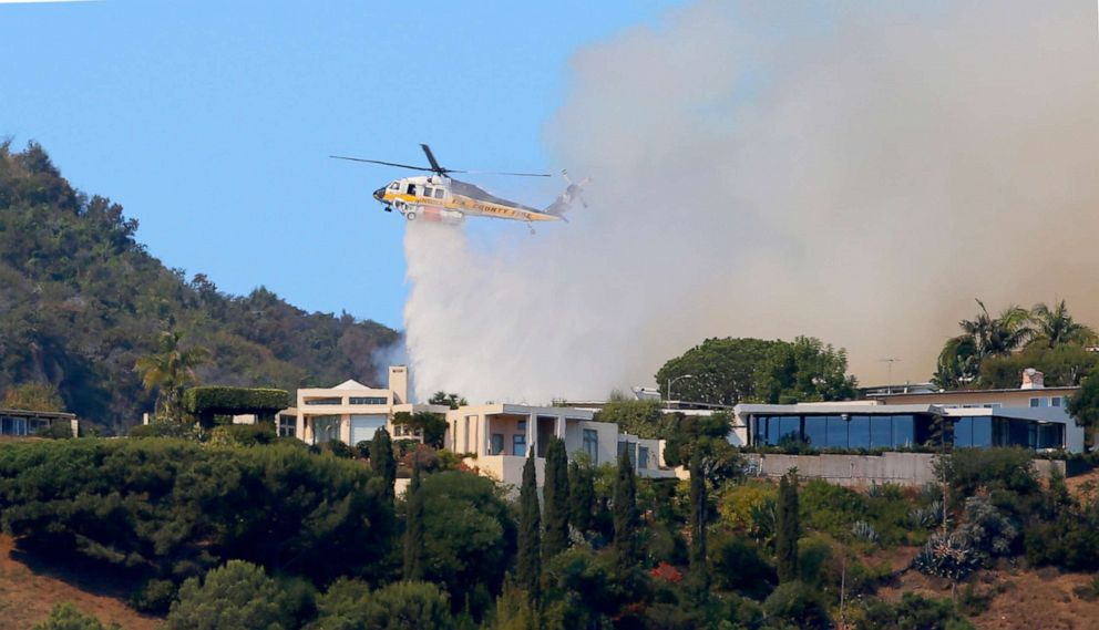 Moving brush fire threatens Pacific Palisades homes