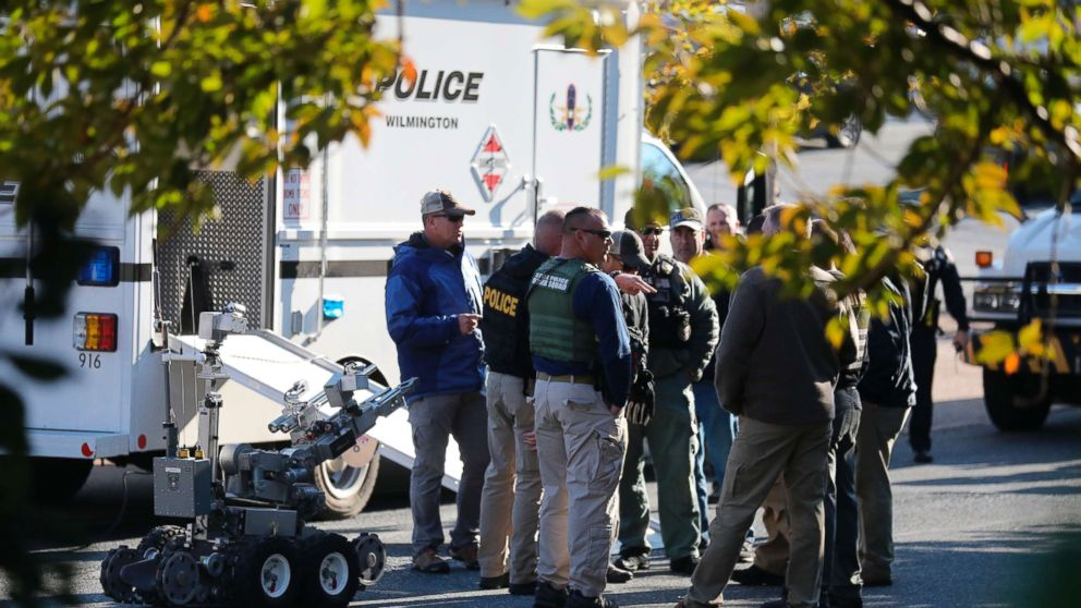Local and federal authorities remove a suspicious package found at a US postal facility in Wilmington, Del., Oct. 25, 2018. A law enforcement official said suspicious packages addressed to former Vice President Joe Biden  were intercepted at Delaware mail facilities in New Castle and Wilmington and were similar to crude pipe bombs sent to former President Barack Obama, Hillary Clinton and CNN.