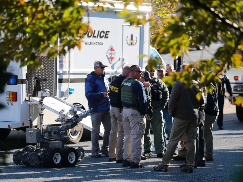 PHOTO: Local and federal authorities remove a suspicious package found at a US postal facility in Wilmington, Del., Oct. 25, 2018. A law enforcement official said suspicious packages addressed to former Vice President Joe Biden were intercepted.