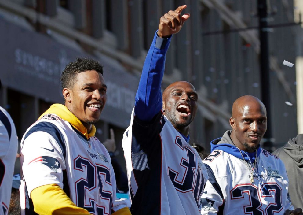 PHOTO: New England Patriots (l-r) Eric Rowe, Jason McCourty and Devin McCourty react to fans during their victory parade through downtown Boston, Feb. 5, 2019, to celebrate their win over the Los Angeles Rams in Sundays NFL Super Bowl 53 football game.
