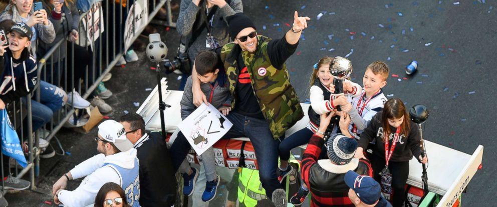PHOTO: New England Patriots quarterback Tom Brady rides with his kids Vivian, Benjamin and Jack during the Super Bowl LIII championship parade, Feb 5, 2019, in Boston.