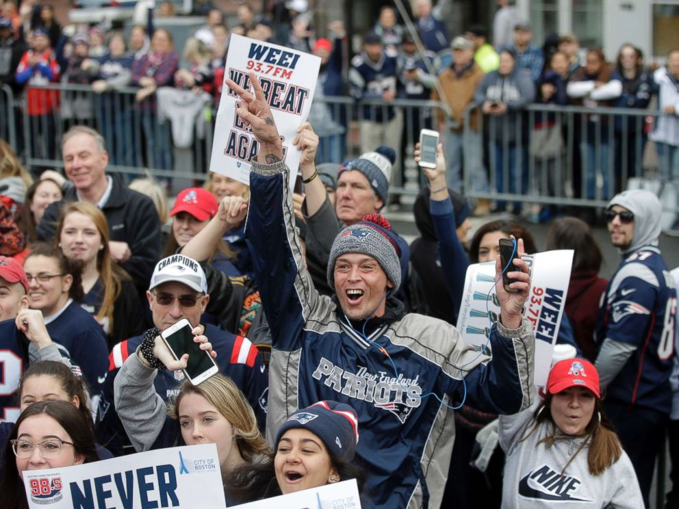 PHOTO: Fans wait for the New England Patriots parade to through downtown Boston, Feb. 5, 2019, to celebrate their win over the Los Angeles Rams in Sundays NFL Super Bowl 53 football game.