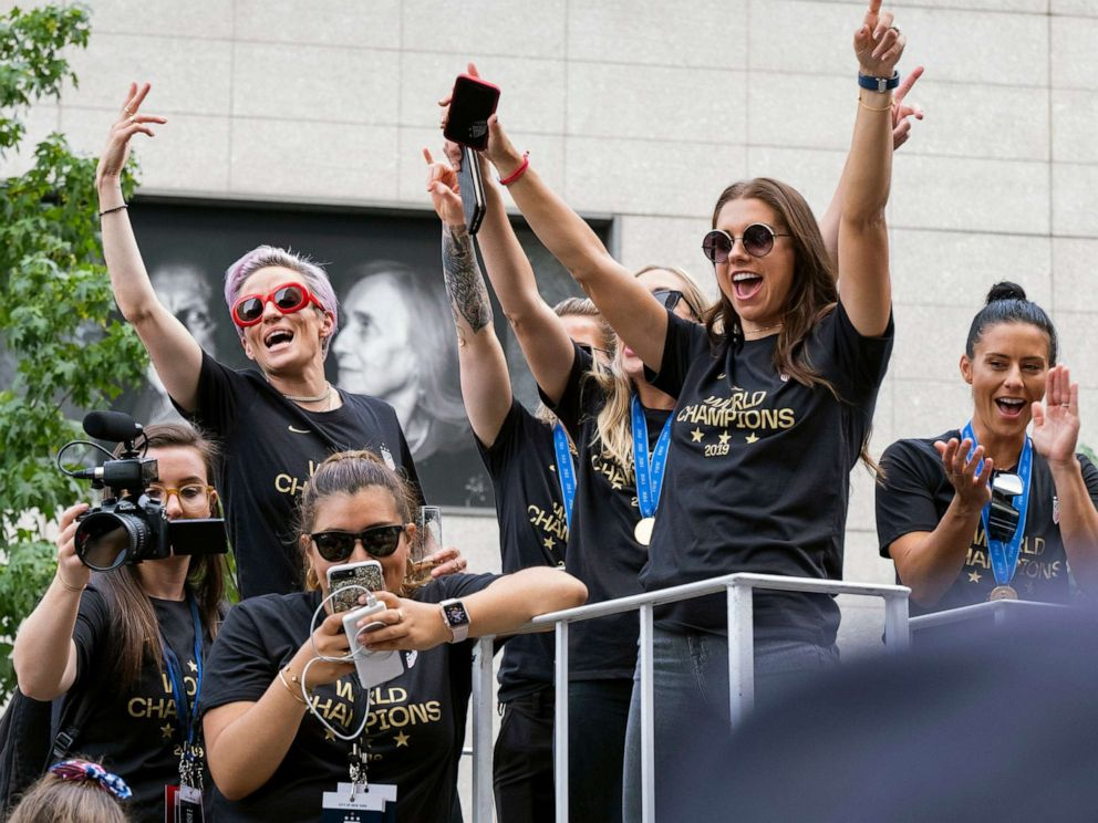 PHOTO: Member of the U.S. womens soccer team, including Megan Rapinoe,left, and Alex Morgan, right, stand on a float before being honored with a ticker tape parade along the Canyon of Heroes, July 10, 2019, in New York.