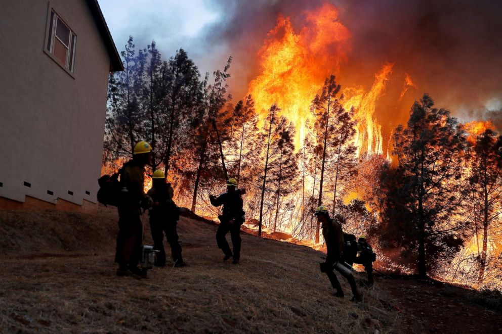 PHOTO: A group of U.S. Forest Service firefighters monitor a back fire while battling to save homes at the Camp Fire in Paradise, Calif., Nov. 8, 2018.