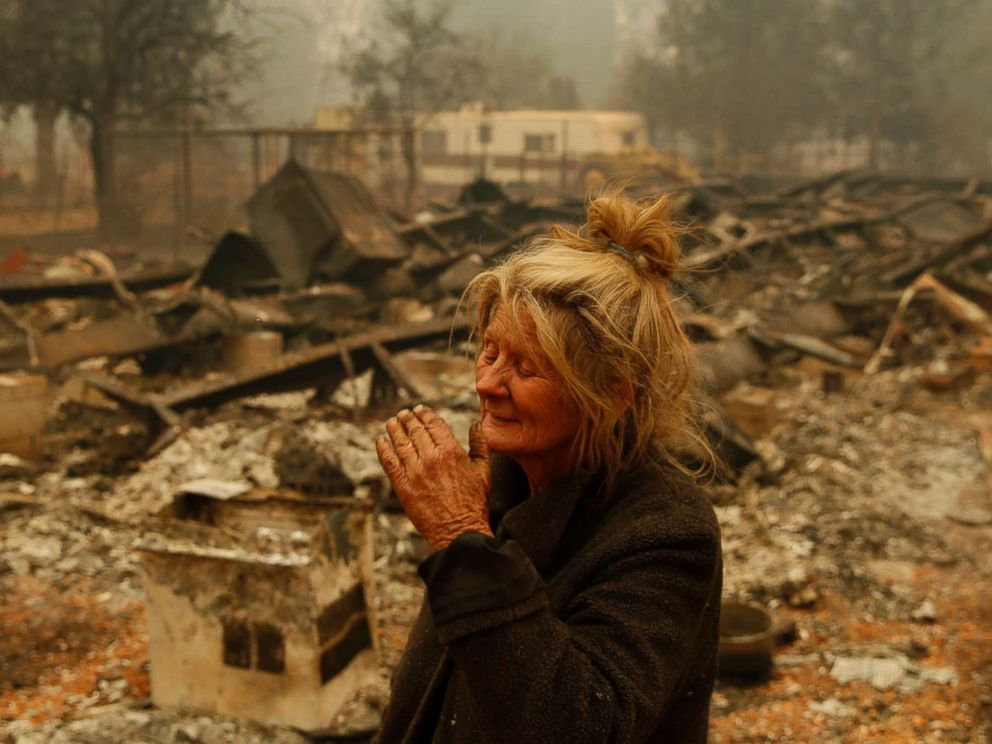 PHOTO: Cathy Fallon reacts as she stands near the charred remains of her home, Friday, Nov. 9, 2018, in Paradise, Calif.