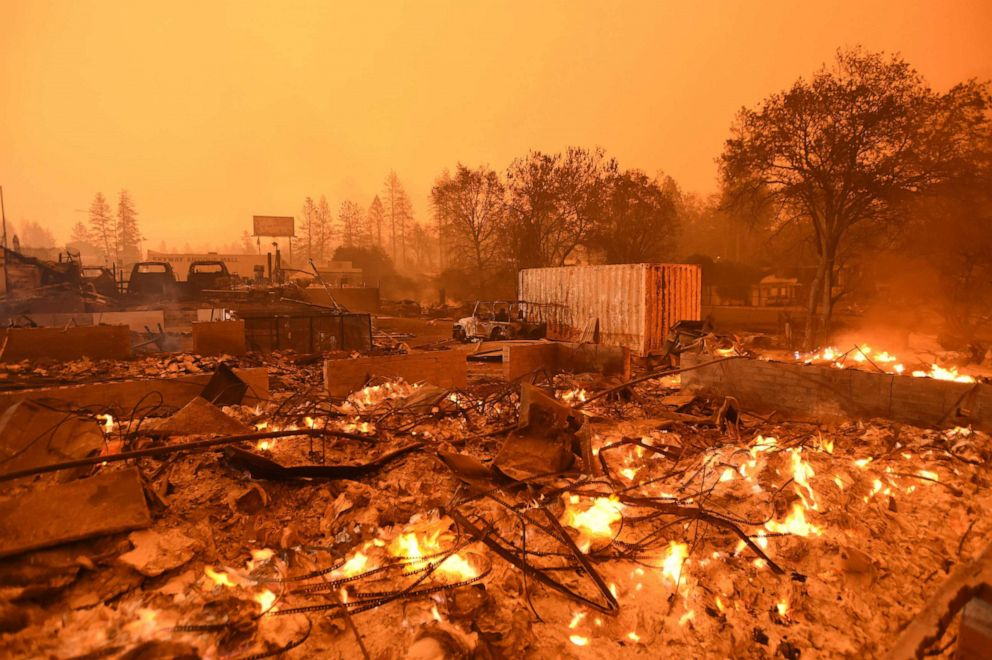 Josh Edelson  AFP  Getty Images Businesses continue to burn under a darkened smokey sky in Paradise north of Sacramento Calif. Nov. 09 2018