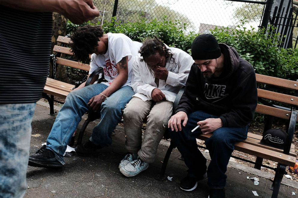 PHOTO: Men sit passed out in a park where heroin users gather to shoot up in the Bronx borough of New York, May 4, 2018.