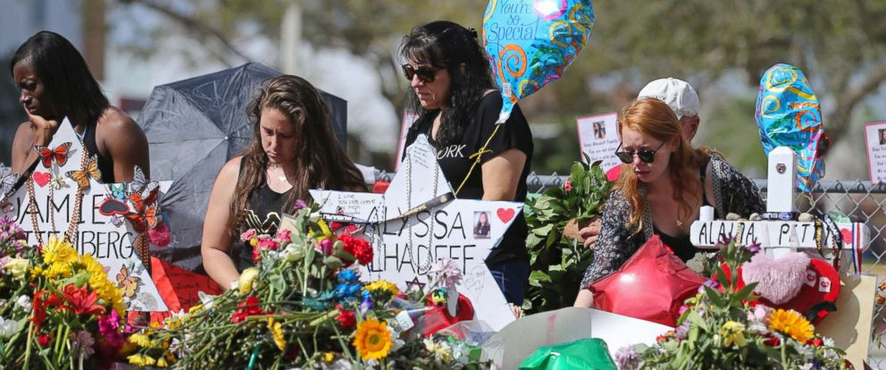 PHOTO: Mourners bring flowers as they pay tribute at a memorial for the victims of the shooting at Marjory Stoneman Douglas High School, Feb. 25, 2018, in Parkland, Fla.