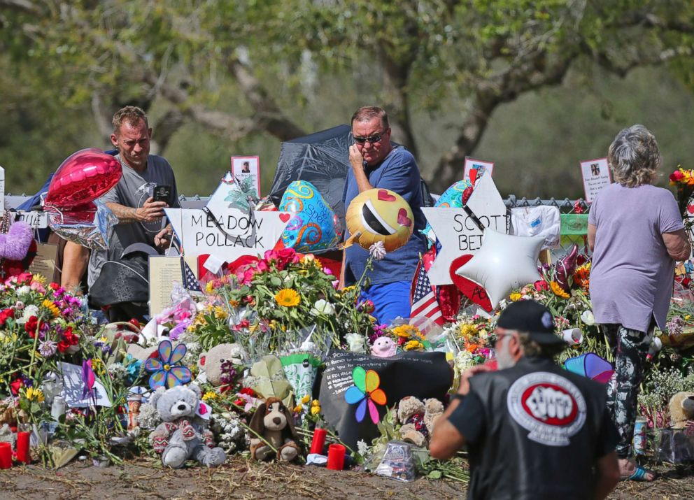 PHOTO: Mourners pay tribute at a memorial for the victims of the shooting at Marjory Stoneman Douglas High School, Feb. 25, 2018, in Parkland, Fla.