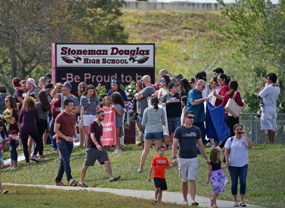 PHOTO: Parents and students arrive at Marjory Stoneman Douglas High School for an open house, Feb. 25, 2018, in Parkland, Fla., as parents and students returned to the school for the first time since the mass shooting on Feb. 14.