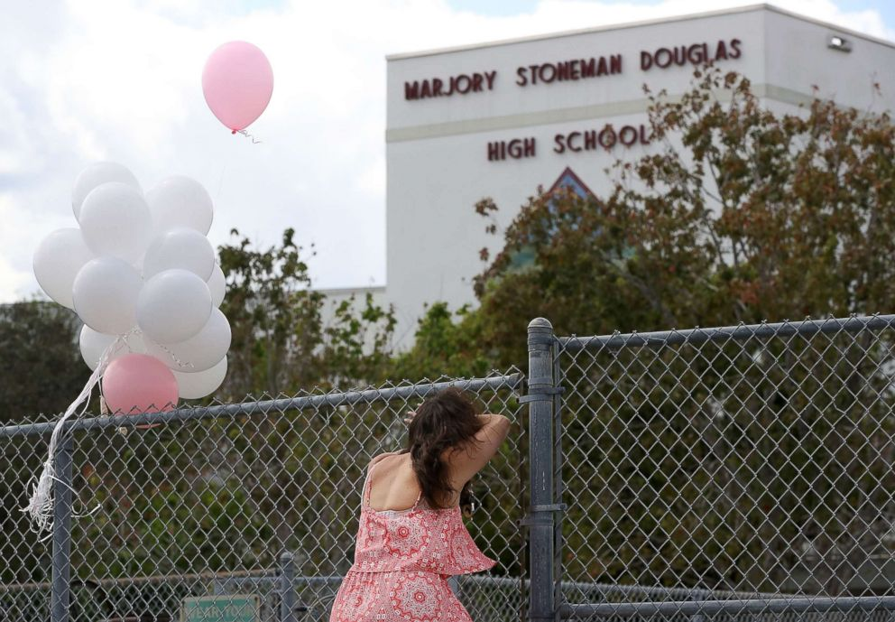 PHOTO: Angela Tanner, rests against the fence that surrounds the Marjory Stoneman Douglas High School, Feb. 18, 2018 in Parkland, Fla.