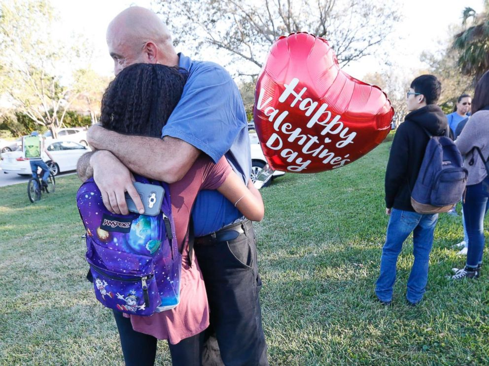 PHOTO: Family members embrace following a shooting at Marjory Stoneman Douglas High School, Feb. 14, 2018, in Parkland, Fla.