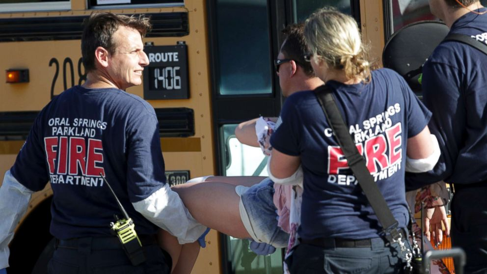 Medical personnel tend to a victim following a shooting at Marjory Stoneman Douglas High School in Parkland, Fla., on Feb. 14, 2018.