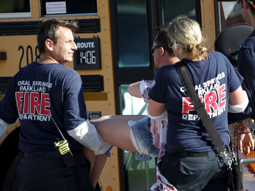 PHOTO: Medical personnel tend to a victim following a shooting at Marjory Stoneman Douglas High School in Parkland, Fla., on Feb. 14, 2018.