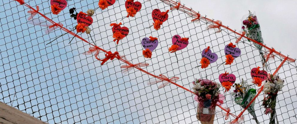 PHOTO: Memorials are seen on a fence surrounding Marjory Stoneman Douglas High School in Parkland, Florida on Feb. 21, 2018.