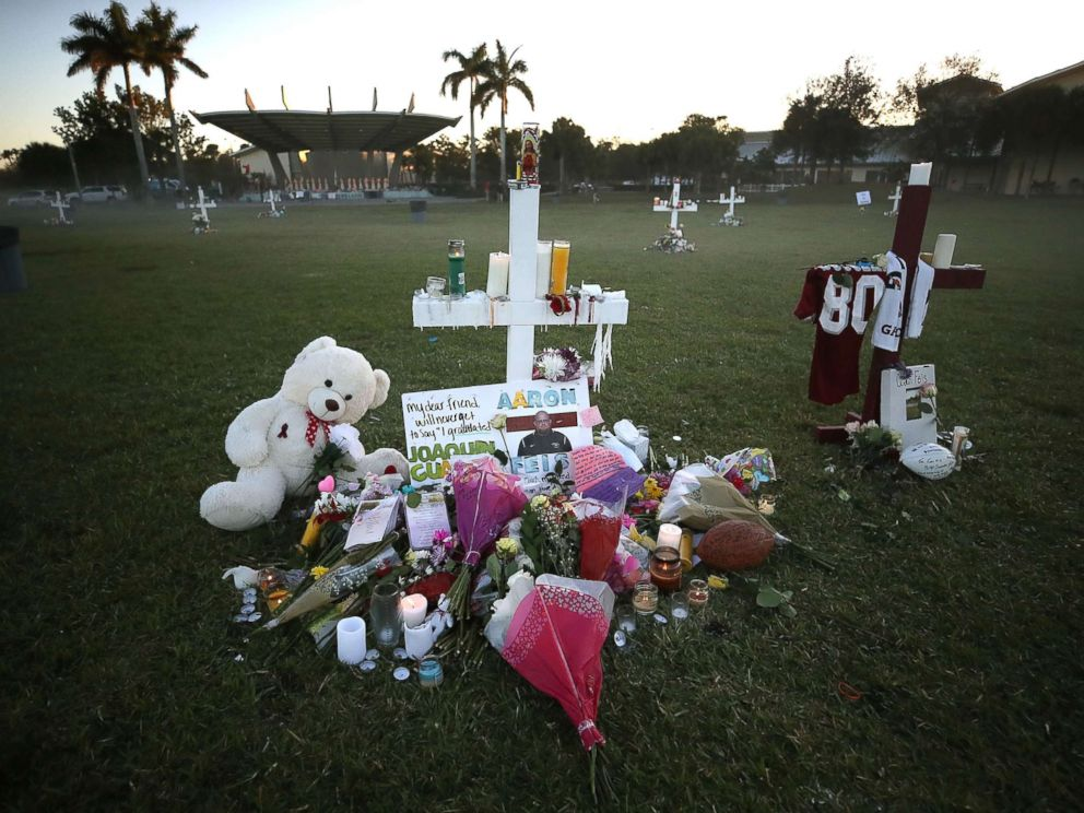 PHOTO: Flowers and mementos are placed on a memorial site, Feb. 17, 2018, for those killed mass shooting at Marjory Stoneman Douglas High School, in Parkland, Fla.