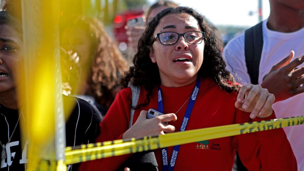 Students are released from a lockdown outside of Stoneman Douglas High School in Parkland, Fla. after reports of an active shooter, Feb. 14, 2018.