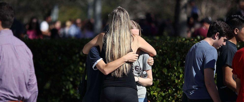 PHOTO: Students of Marjory Stoneman Douglas High School gather at Pine Trail Park, on Feb. 15, 2018 in Parkland, Fla., the day after a mass shooting in the school.