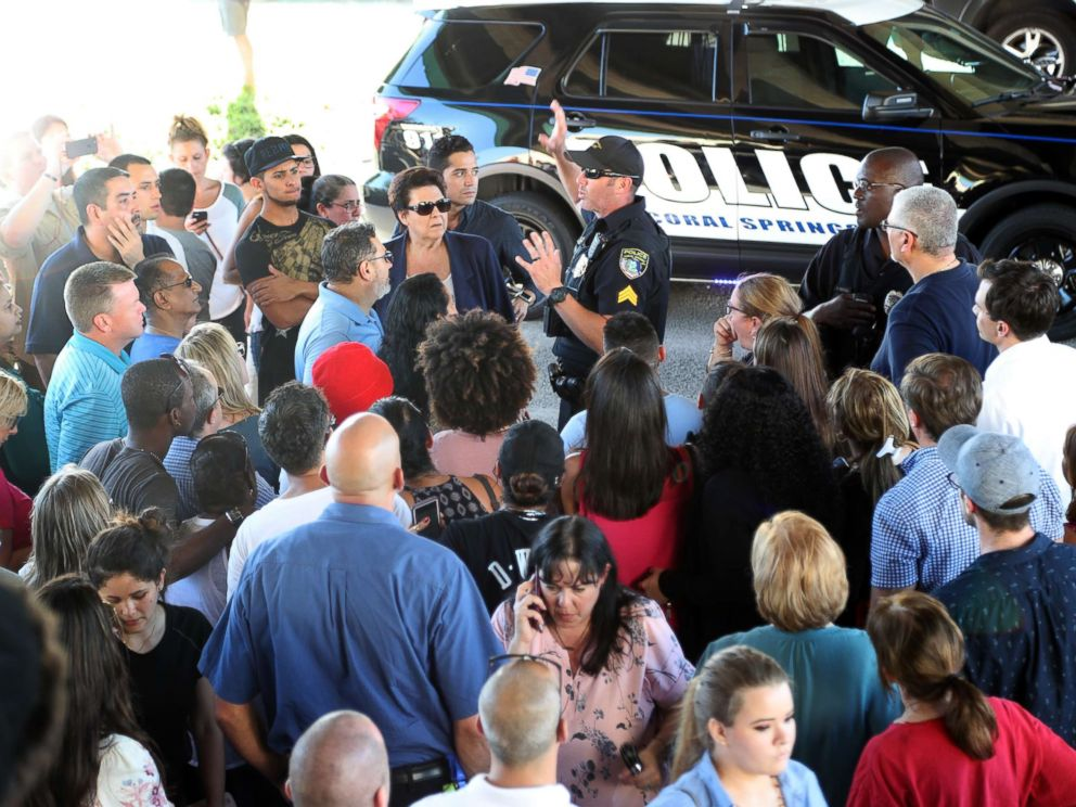 PHOTO: An officer talks to parents of students from Stoneman Douglas High School in Parkland, Fla., after a shooting on Feb. 14, 2018.