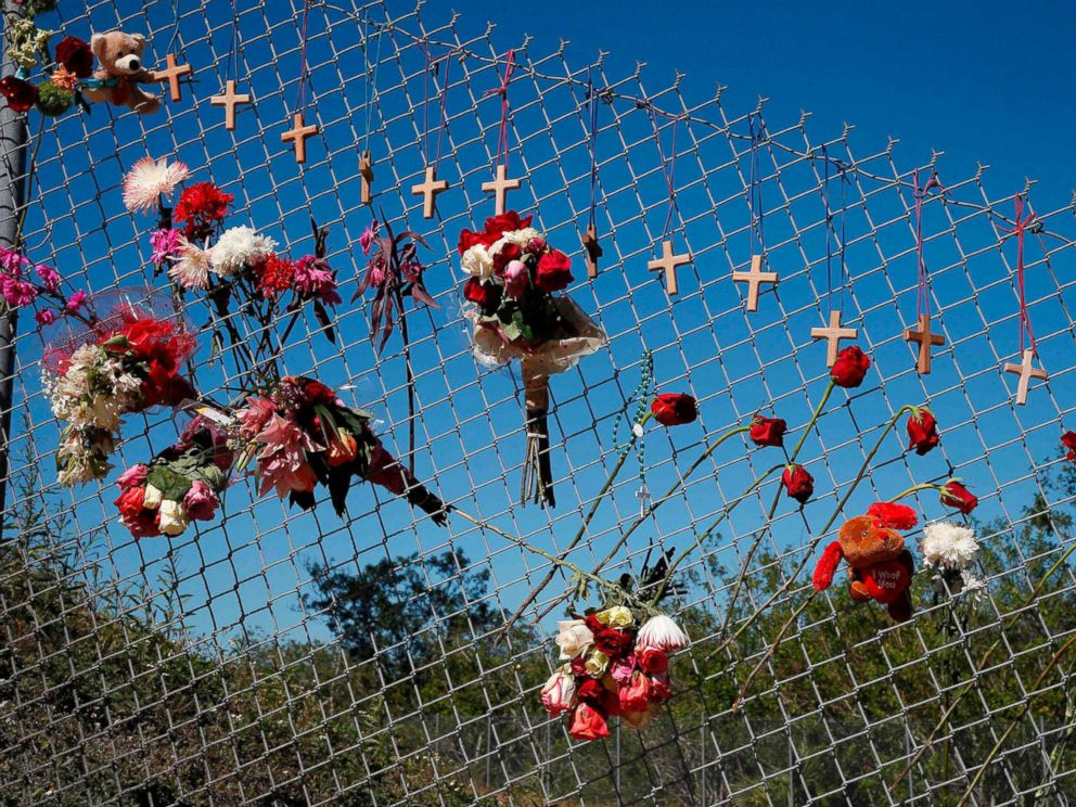 PHOTO: Flowers and crosses line a fence near the school on a makeshift memorial for the victims of the Marjory Stoneman Douglas High School shooting in Parkland, Fla., Feb. 16, 2018.