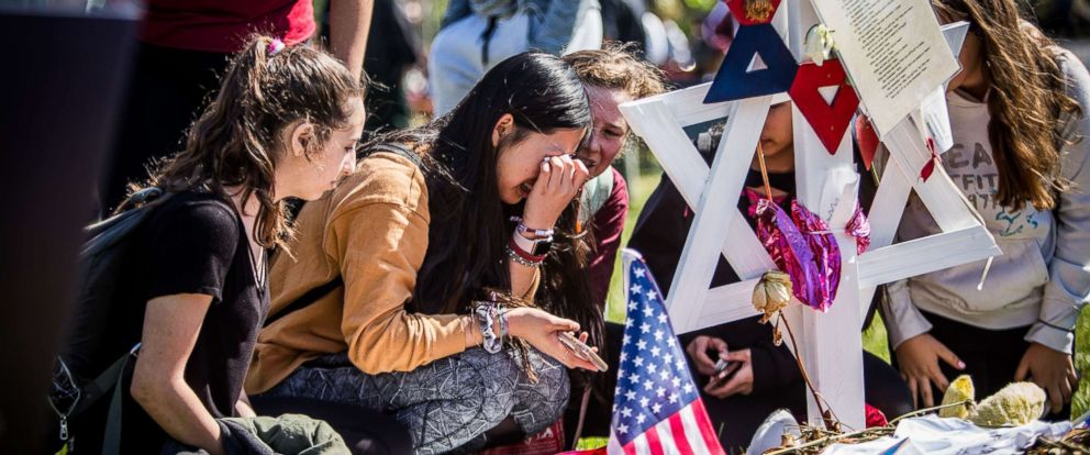 PHOTO: Students visit the memorials of their friends at Marjory Stoneman Douglas High School in Parkland, Fla., following the walkouts on March 14, 2018.