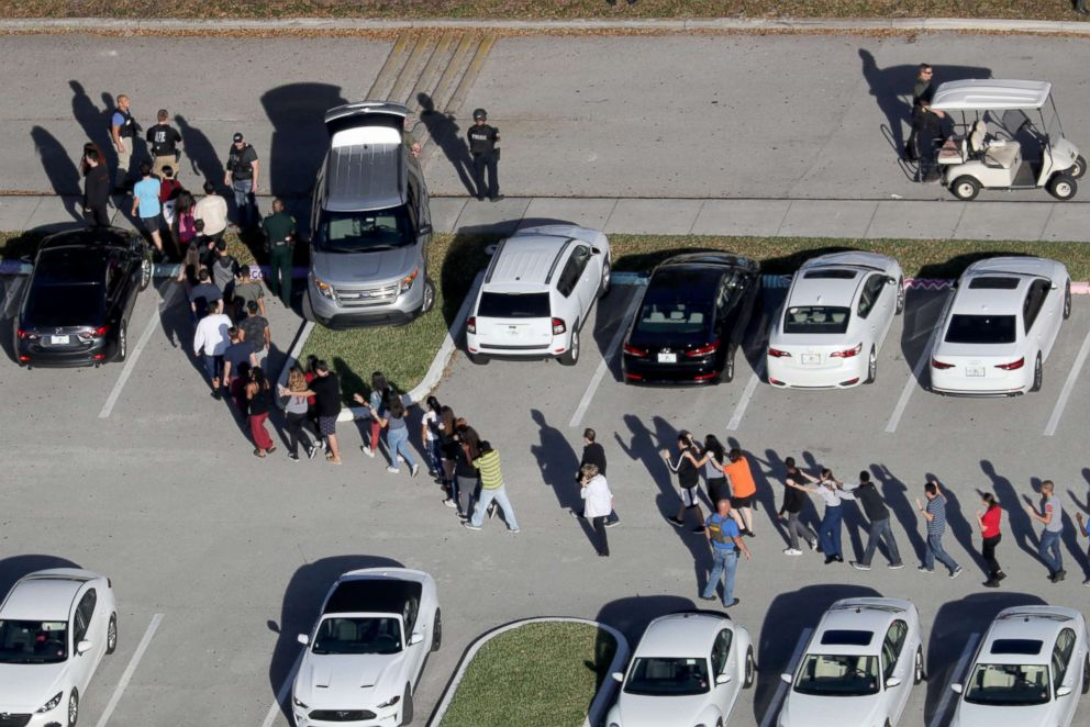 PHOTO: Students are evacuated by police out of Stoneman Douglas High School in Parkland, Fla., after a shooting on Feb. 14, 2018.